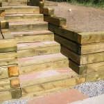 Wood retaining Wall with flagstone treads built by Landscaping Company Gardenhart Landscape & Design