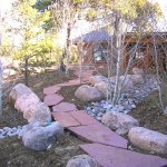 Rose Flagstone Bridge over Drainage Swale by Gardenhart Landscape & Design