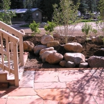 Flagstone Patio Screened by Aspen and Native Roses planted by Gardenhart Landscape & Design
