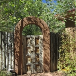 Garden gate with aspen and flagstone Durango Landscaping company Gardenhart Landscape & Design