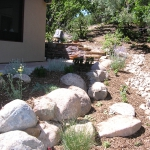Repairing Drainage issues with Cobble Swale and Boulders in Landscape Design in Durango CO by Gardenhart Landscape & Design