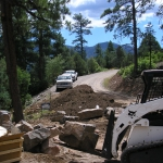 Planting with Equipment like a skid steer and installing xeric perennials in Durango Colorado by Gardenhart Landscape & Design