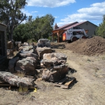 Boulders are stockpiled and sized for placement in a rock garden landscape near Durango, CO