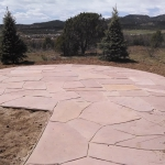 Landscape Design included Circular Patio, Evergreen Trees, Shrubs, Perennials and informal flagstone walkway in Durango