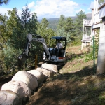 Tractor moving bolders on site construction