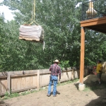 Utilizing a crane to lift 2.5 tons of flagstone into a difficult to access backyard in Durango CO