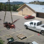Landscaping with a Crane in a backyard in Durango Colorado by Gardenhart Landscape & Design
